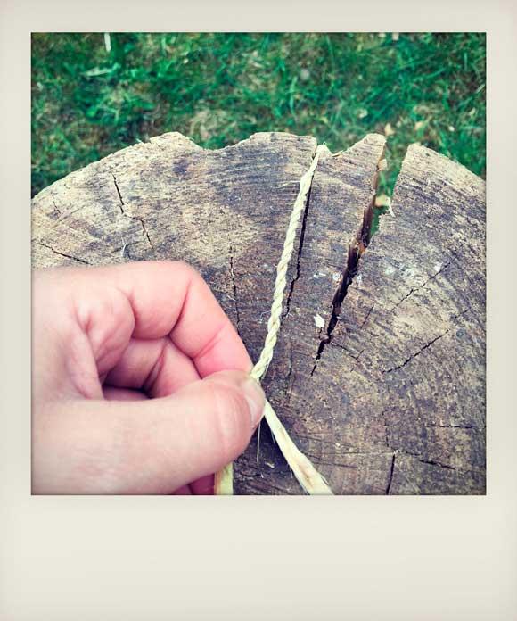 Hands weaving rope