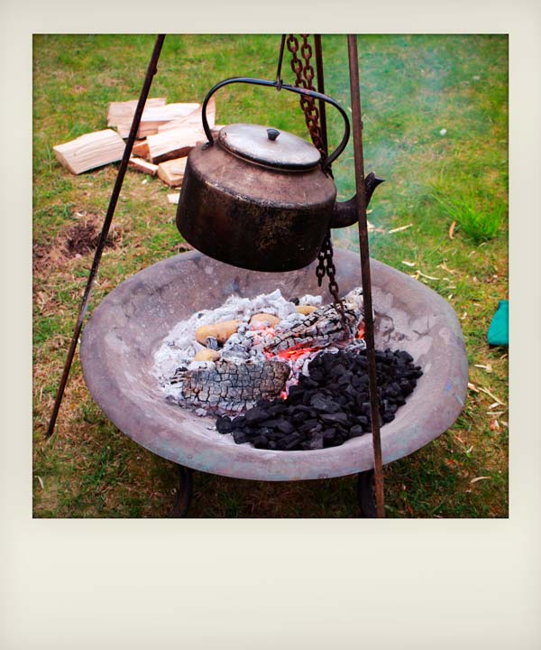 large kettle boiling over an open fire