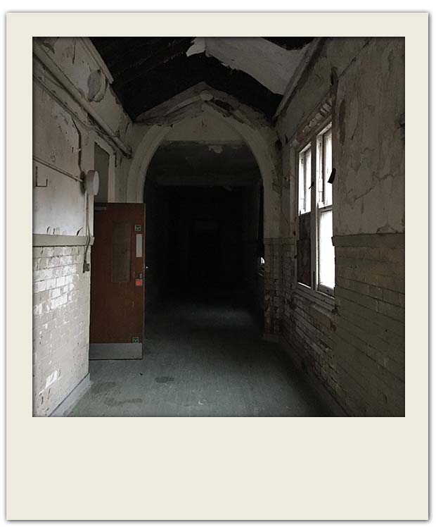 a dark corridor inside Newsham Park Hospital