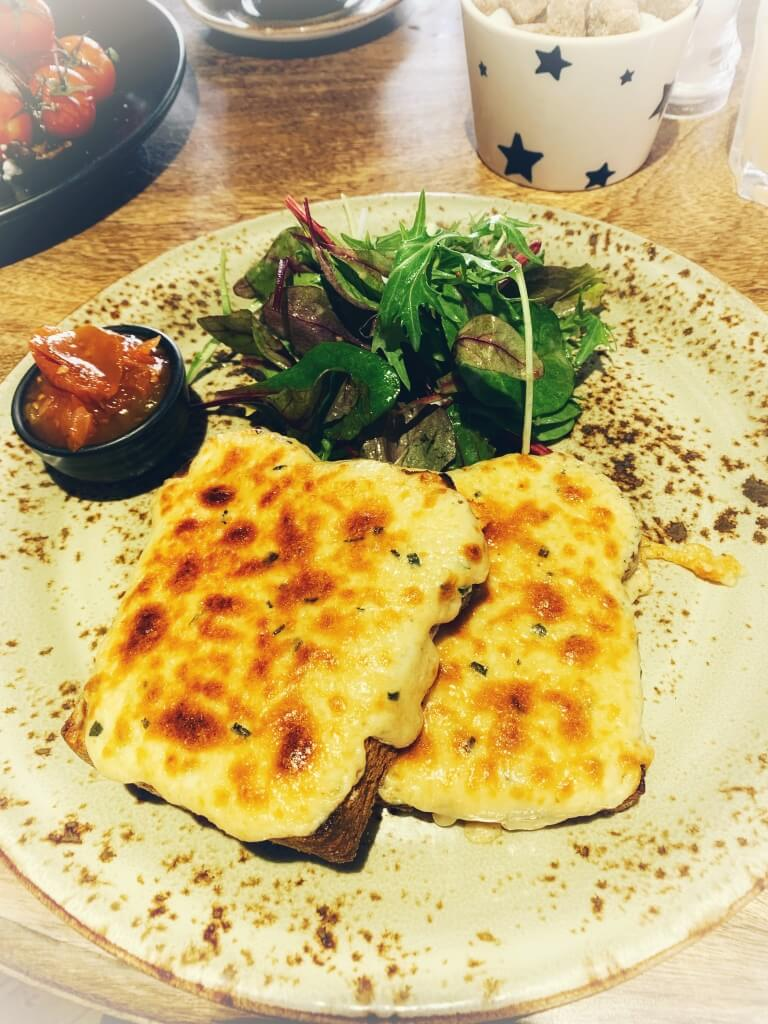 Very cheesy Welsh Rarebit with side salad and chutney