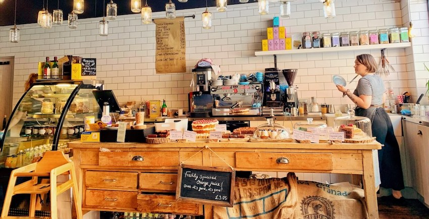 Inside Brew & Brownie, York. A photo of the counter displaying all the delicious cakes