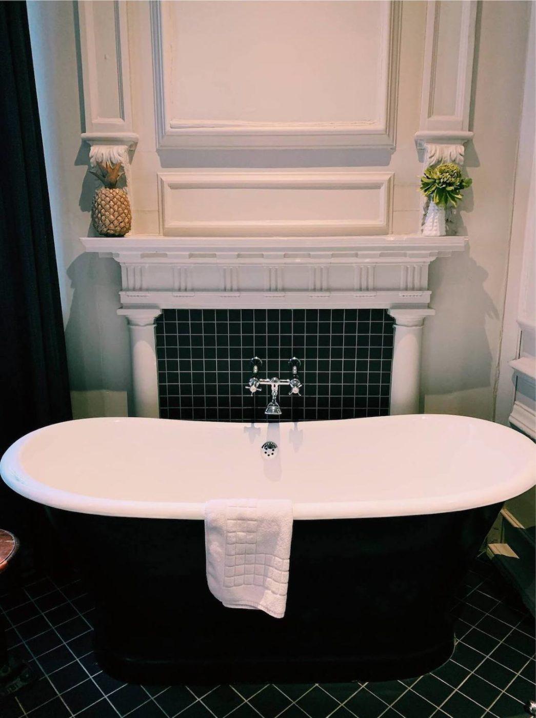 freestanding bathtub in bedroom of the Judges Court Hotel