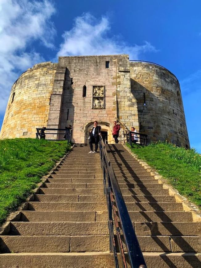 Helen standing on the steps leading up to Clifford's Tower