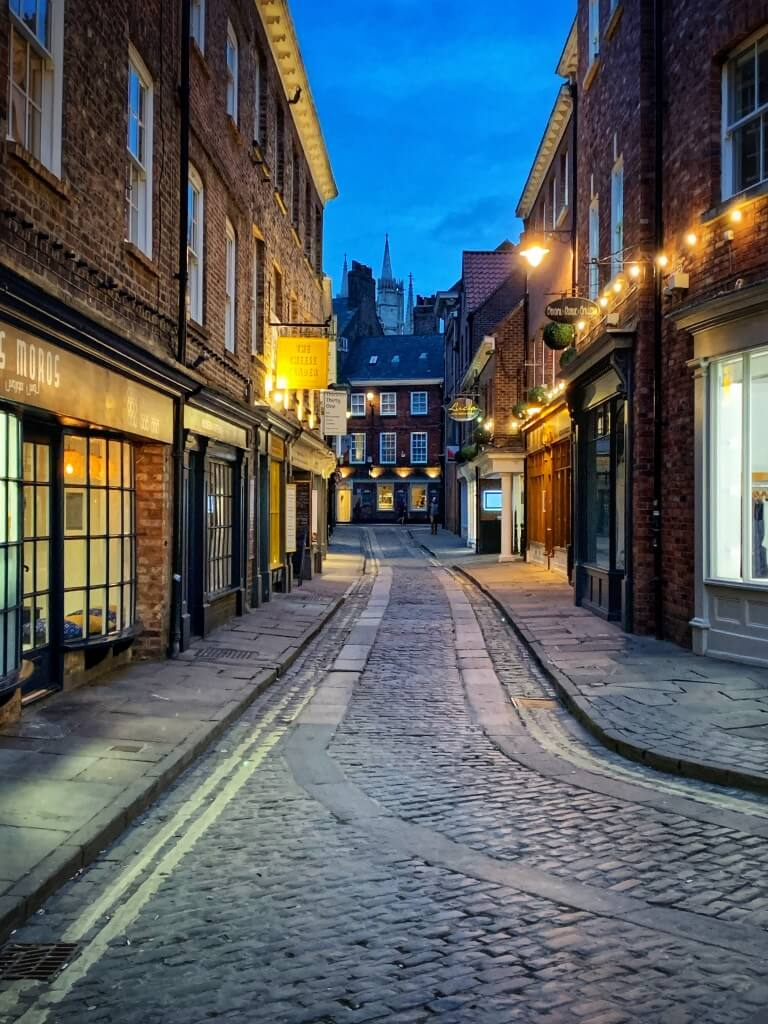 An empty cobbled York street at dusk