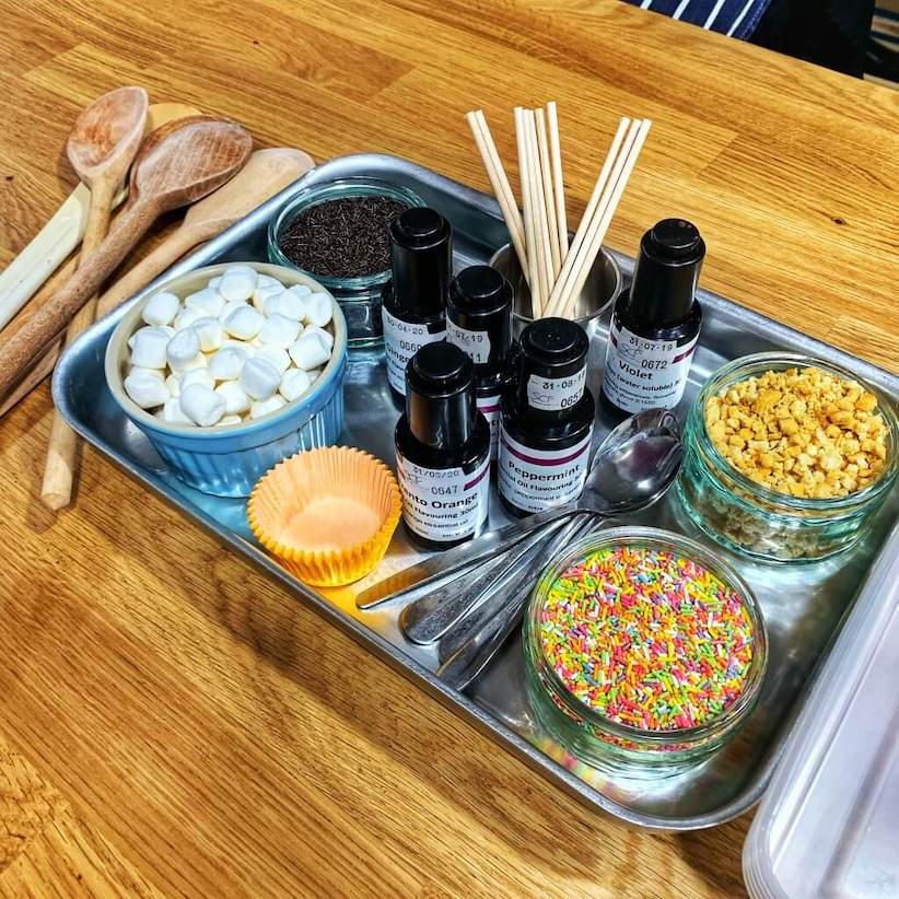 a tray of ingredients to make a chocolate lollipop.