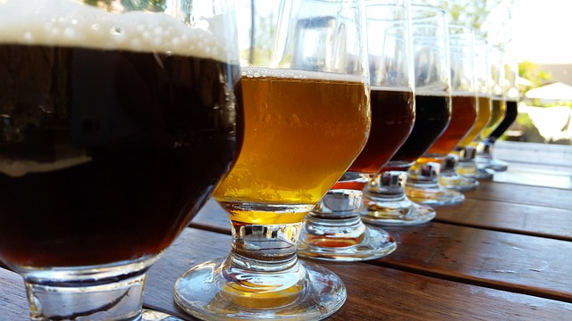 glasses of different coloured beers in a line