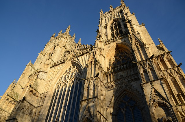 view of York Minster against blue skies from the ground up