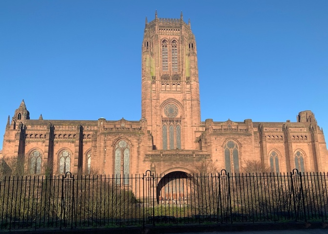 Side view of the impressive Liverpool Anglican Cathedral against blue skies