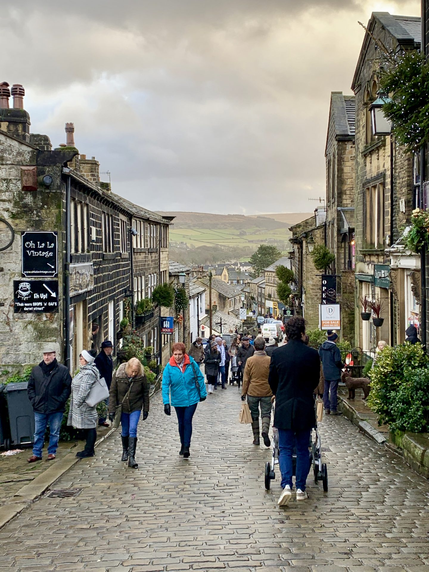 the main shopping street in Haworth on wet and grey day - the perfect day trip from York