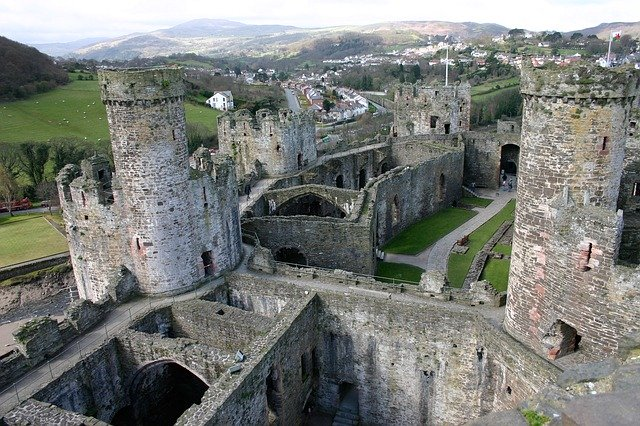 A birds eye view of Conwy Castle. The welsh hills can be seen in the background