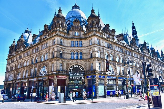 view of the corner of Leeds City Market against blue skies