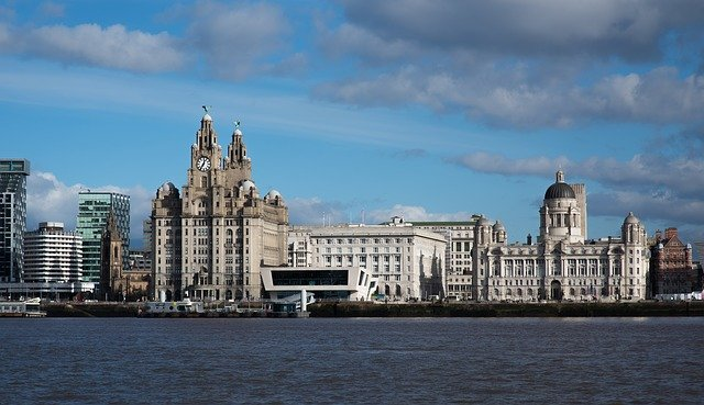 Liverpool waterfront set against blue skies and white clouds