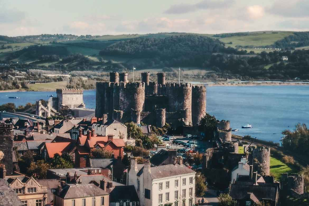 A view across Conwy towards the castle with the river beyond
