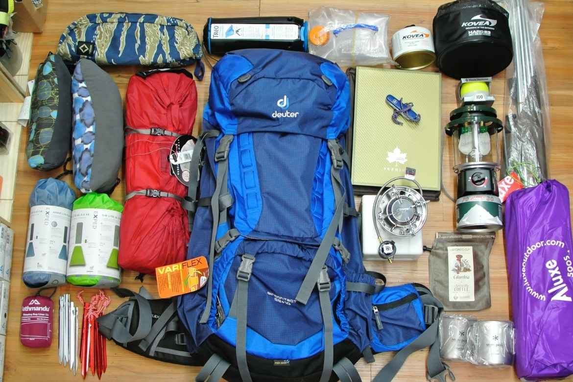 lots of camping gear laid out on a table
