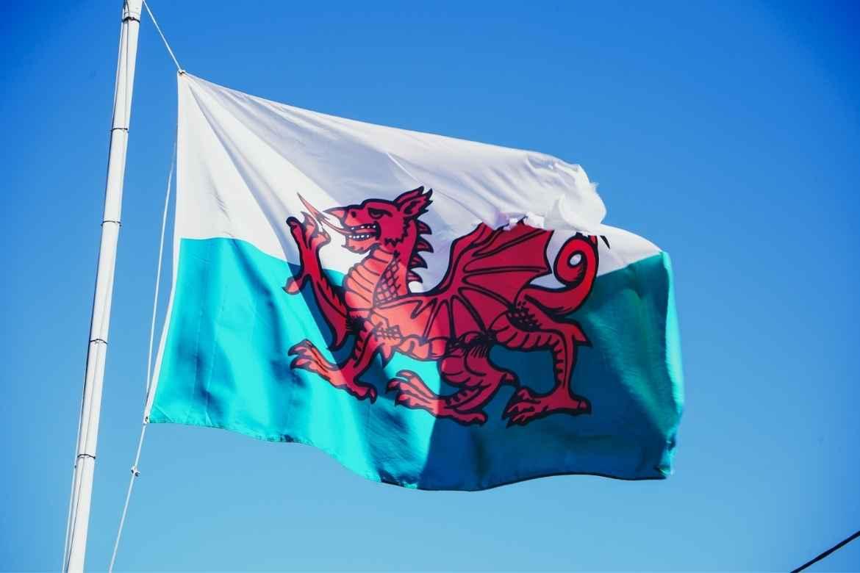 Welsh flag against blue sky